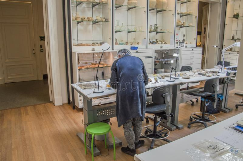 Person Working At An Archeology Lab Allard Pierson Museum Amsterdam The Netherlands royalty free stock image
