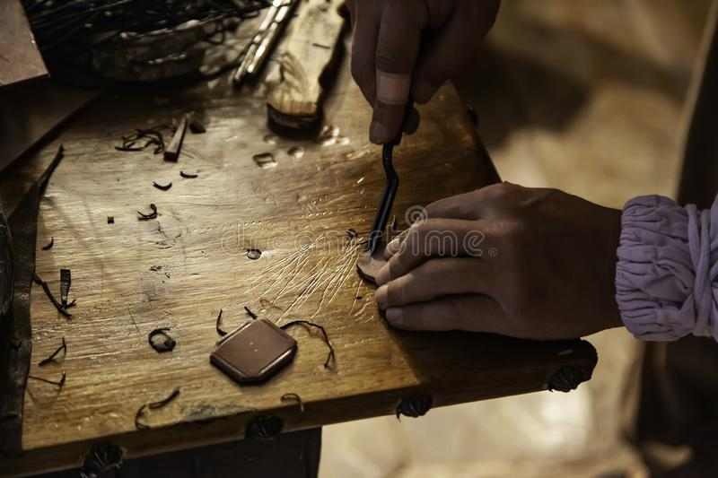 Person working with leather. In traditional way, artisan work detail stock images