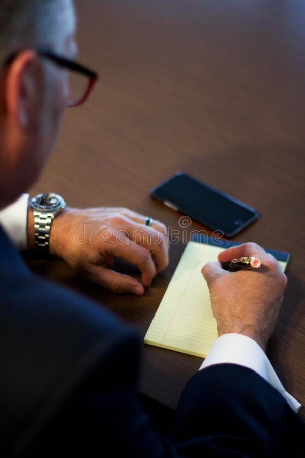 Person Writing Notes on White Ruled Paper stock images