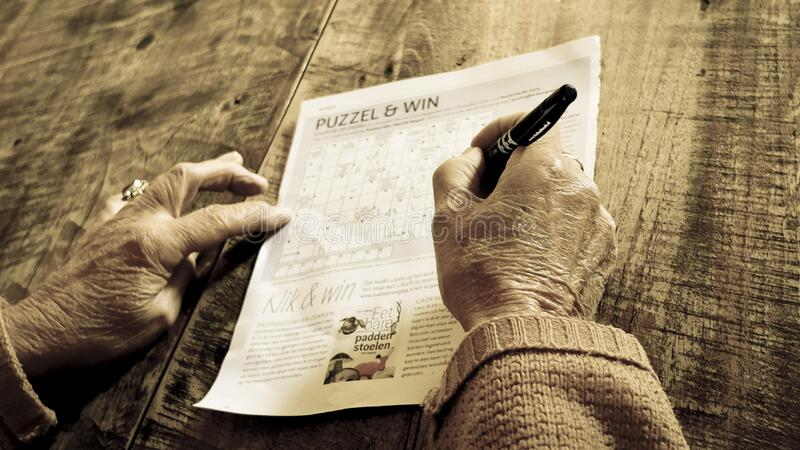 Person Writing On Puzzle & Win Paper Free Public Domain Cc0 Image