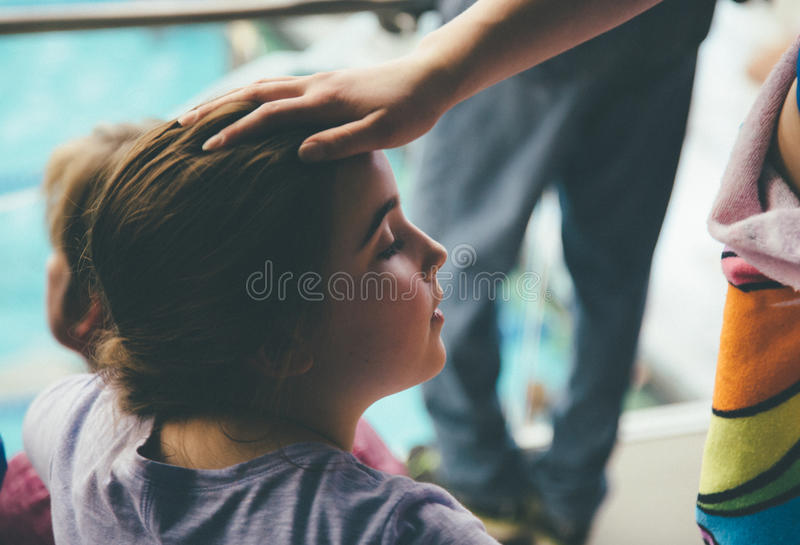 Person's Right Hand On Head Of Girl In Gray Shirt Free Public Domain Cc0 Image