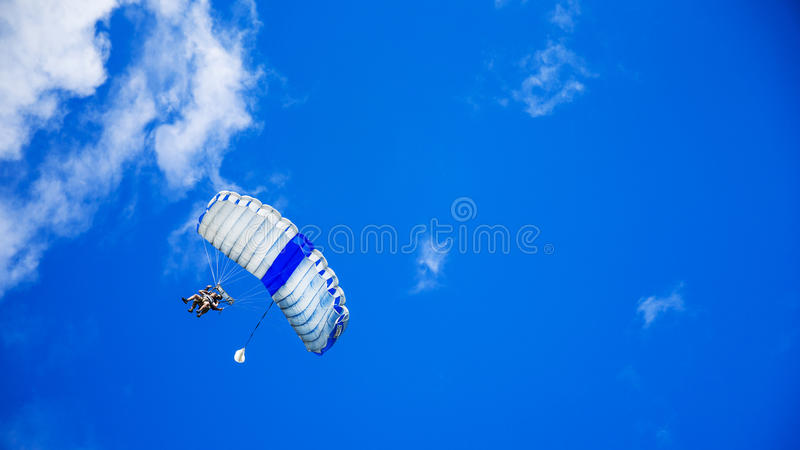 Person In Yellow Suit Flying With The Parachute Under Blue Calm Sky During Daytime Free Public Domain Cc0 Image