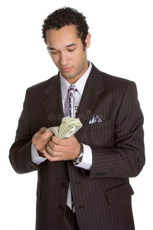 Persona che conta soldi immagine stock