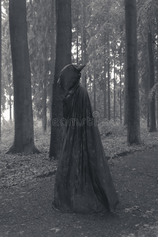 Persona con el cabo oscuro foto de archivo