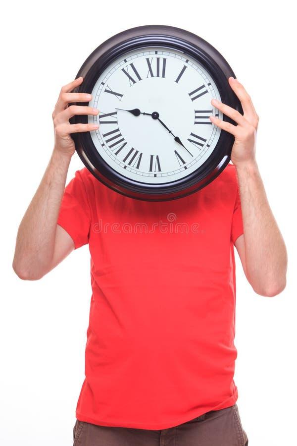 Persona con il grande orologio invece della testa immagini stock libere da diritti