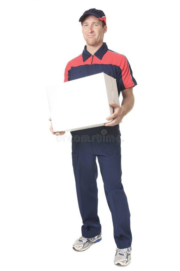Persona de la entrega que entrega sostenerse de los paquetes imágenes de archivo libres de regalías