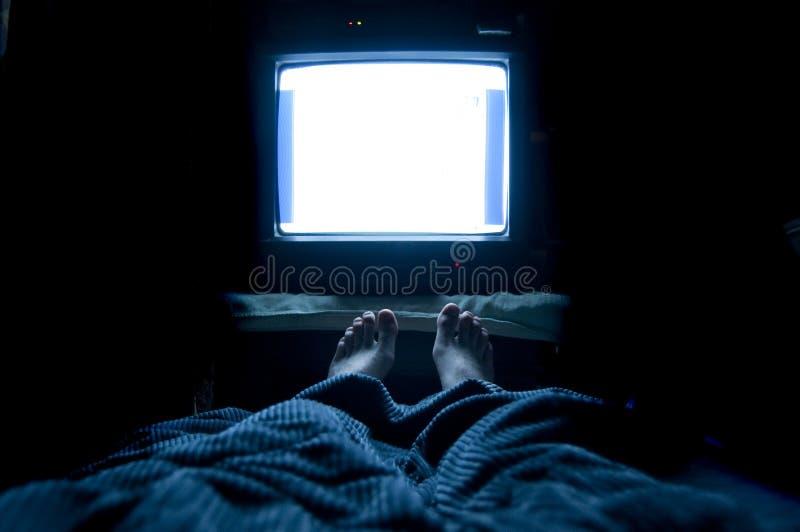 Persona dedita della televisione immagine stock
