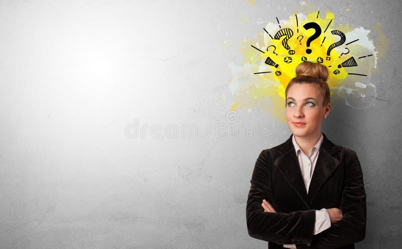 Persona del negocio con los signos de interrogaci?n imagen de archivo libre de regalías