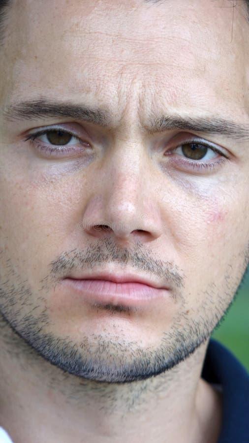 Persona italiana sin afeitar impasible imágenes de archivo libres de regalías
