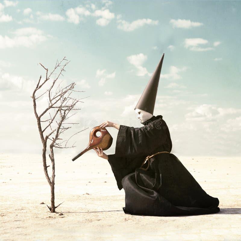 Persona misteriosa que riega una planta seca imagen de archivo libre de regalías