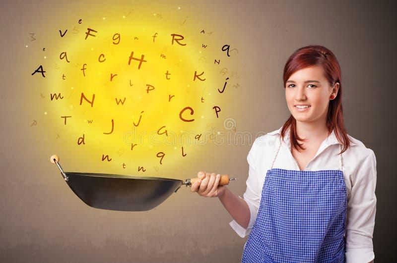 Persona que cocina letras en wok imágenes de archivo libres de regalías
