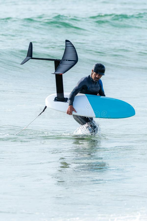 Persona que practica surf de Hidrofoil imágenes de archivo libres de regalías