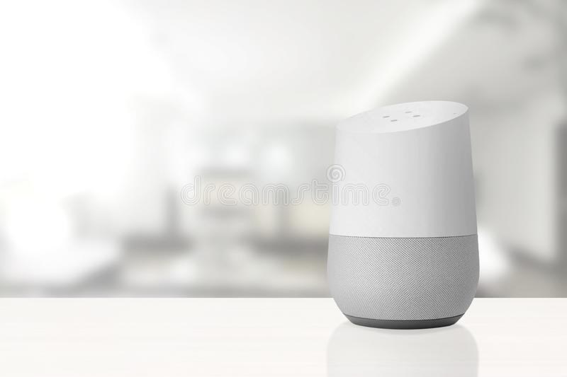 Personal assistant loudspeaker on a white wooden shelf of a smart home living room. Next, a book. Empty copy space royalty free stock photography
