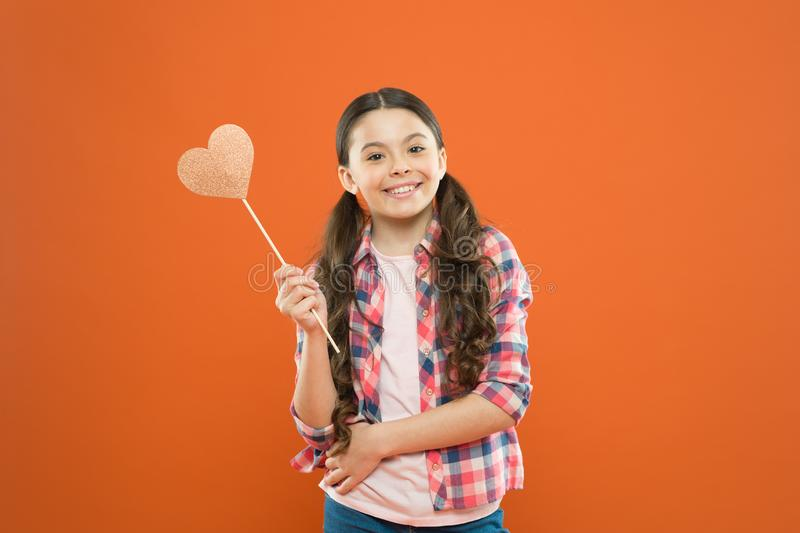 Personal attitude. I definitely like this. Vote for love. Girl little child hold heart symbol on stick. Like and support. Valentines day. Fall in love. Love stock photography