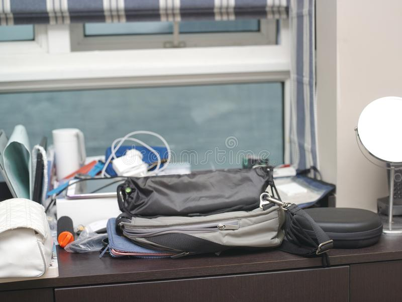 Personal Belongings On Table. Personal belongings on a table against the window stock photography