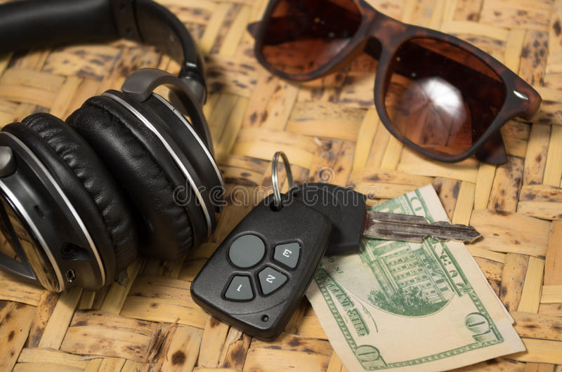 Personal belongings of typical woman, daily life. Concept, mobile phone, car keys, glasses and money spread out stock photos