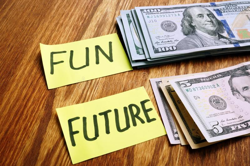 Personal budget money for fun and savings for future. On desk stock photo