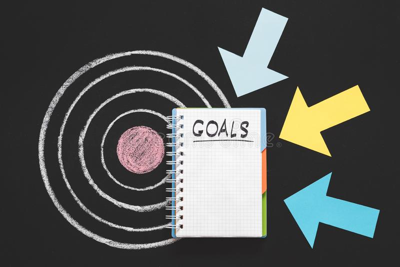 Personal business goals aim aspiration inspiration. Personal and business goals. Priorities and aims. Aspiration and inspiration. Arrows pointing at notepad on royalty free stock images