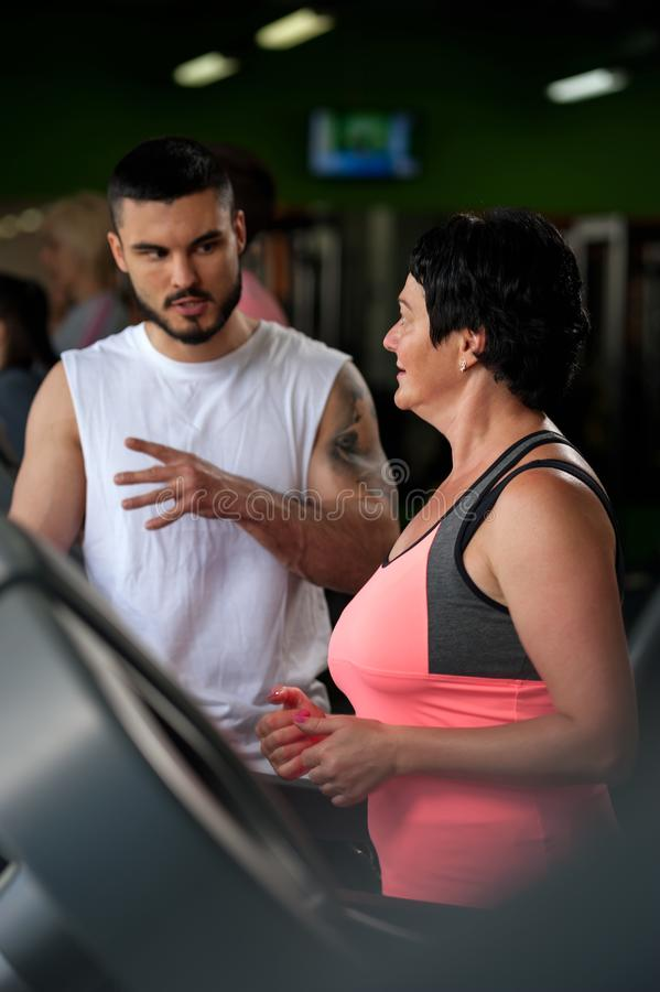 Personal coach with female middle aged client royalty free stock images