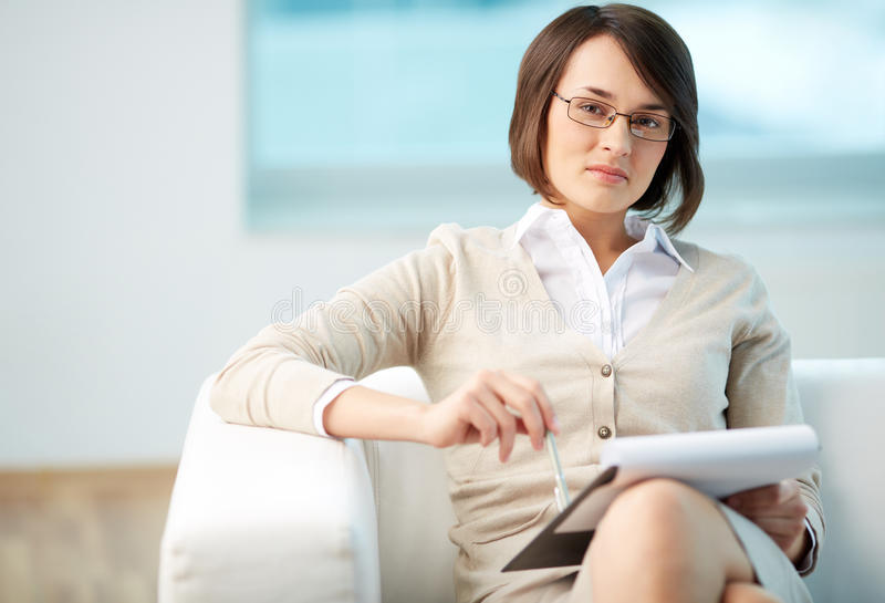 Personal counselor. Portrait of a friendly counselor being ready to take notes royalty free stock photo