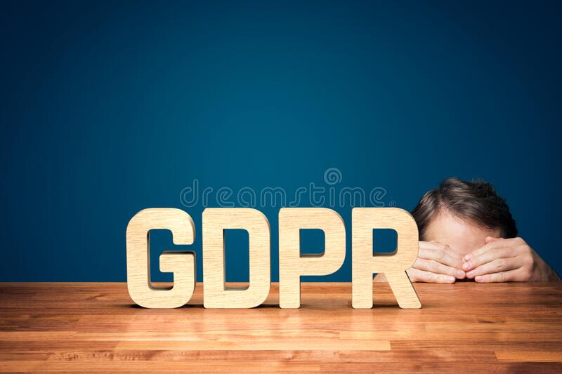 Personal data protection and GDPR concept. Personal data protection, sensitive personal data protection and GDPR concepts. Person is hiding behind the table in stock photos