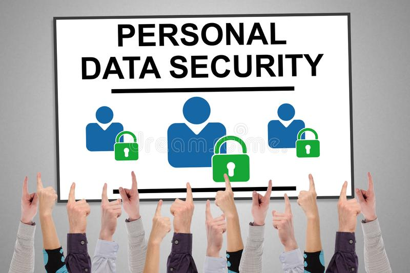 Personal data security concept on a whiteboard. Pointed by several fingers stock photography
