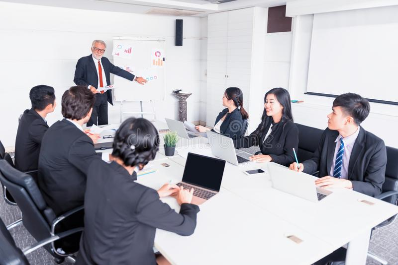 Personal development, coaching and training course for Business teamwork. Meeting and discussing with colleagues in conference room stock images