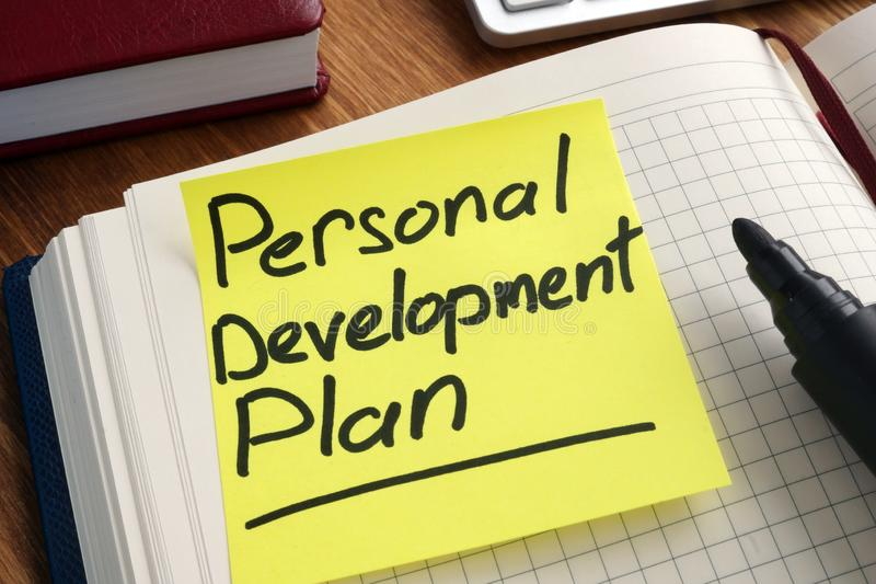 Personal development plan. Memo stick in the notepad stock photo