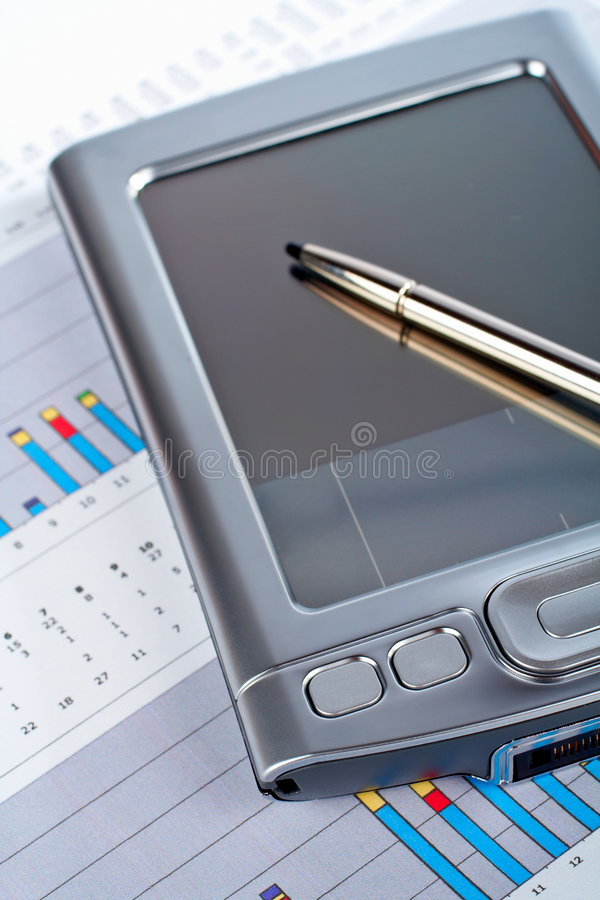 Download Personal Digital Assistant On Market Financial Chart Background Royalty Free Stock Image - Image: 1517926