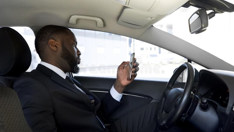 Personal driver waiting his boss, shopping reading news in social networks stock photo