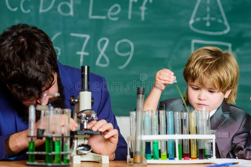 Personal example and inspiration. Study educational activity through experience. I love study in school. Teacher and boy stock photo