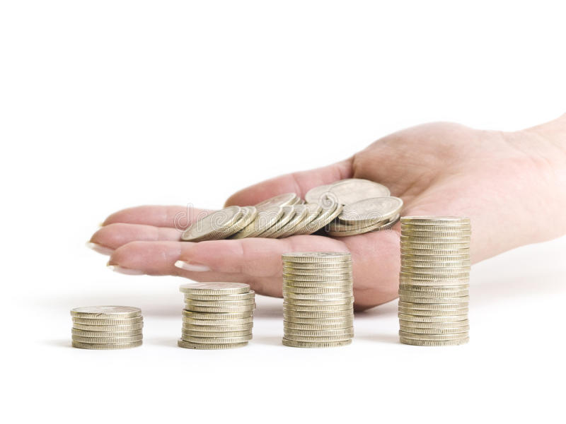 Personal Finance. With hand and coins stock photography