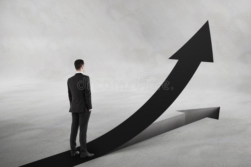 Personal growth and motivation concept with businessman looking at black upward road-arrow royalty free stock image
