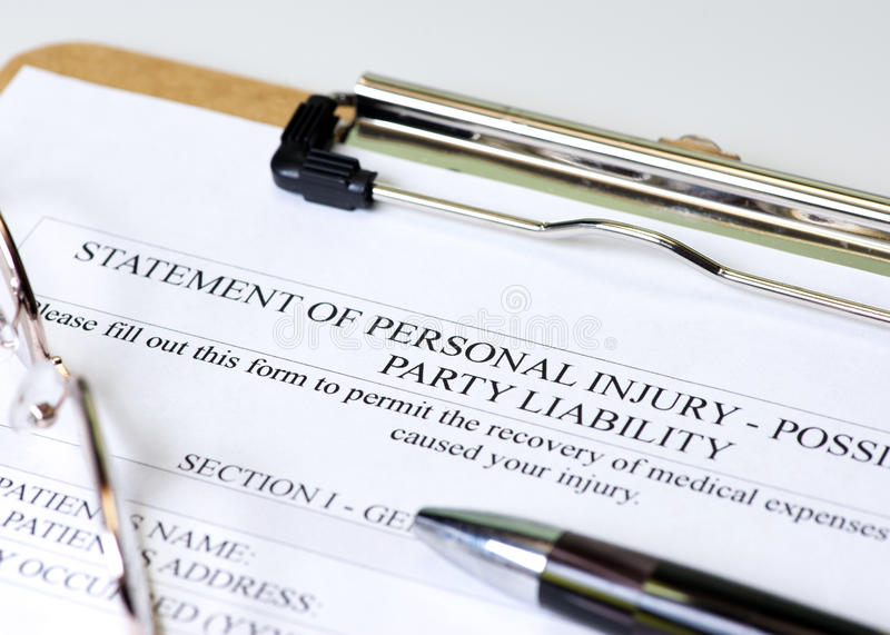 Personal Injury. Claim on clipboard with pen and glasses royalty free stock photos