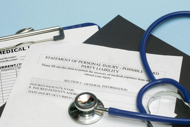 Personal Injury Form. Statement of personal injury form with patient chart and stethoscope stock images
