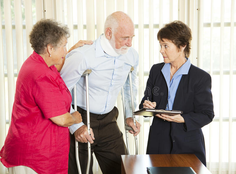 Personal Injury Law. Injured man consulting an attorney about a lawsuit royalty free stock photo