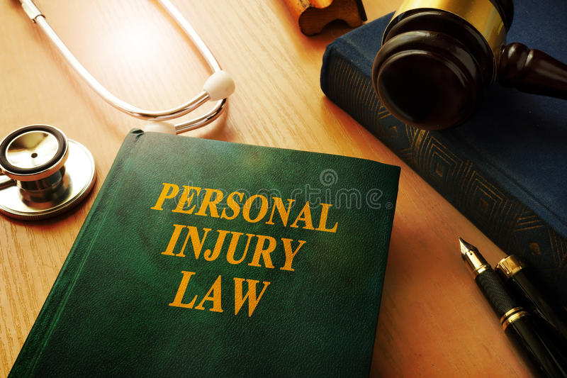 Personal injury law. Personal injury law book on a table royalty free stock photos