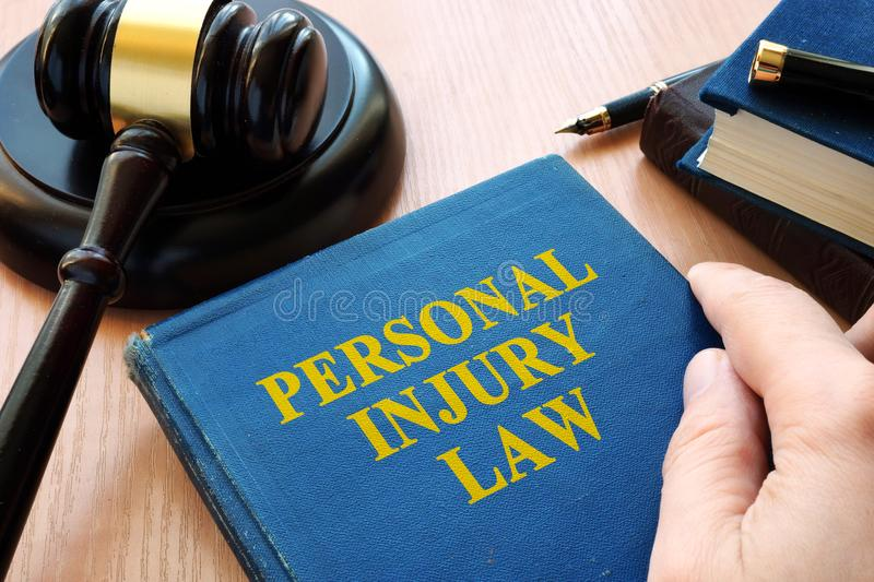 Personal injury law and gavel. Personal injury law and gavel on a desk stock photo