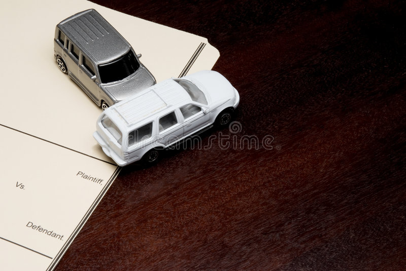 Personal Injury Lawsuit. A Personal Injury Lawsuit with model cars royalty free stock images