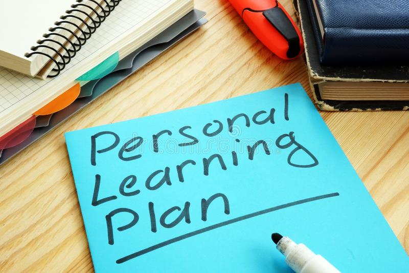 Personal Learning Plan sign with notepads royalty free stock photography