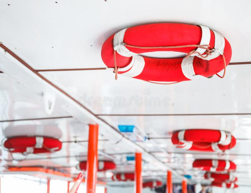 Personal life support flotation safety device life buoy for swimmers, passengers or marine personnel working on boat or area. Exposed to water. Drowning stock image
