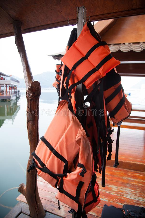 Personal life support flotation safety device life jacket, life vest, work vest, life saving, buoyancy aid or flotation suit for. Marine personnel working on stock photos
