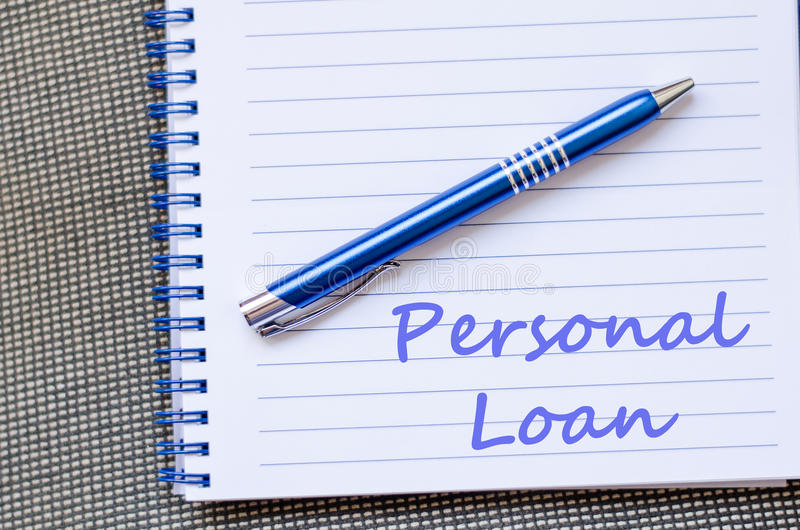 Personal loan write on notebook. Personal loan text concept write on notebook with pen stock images