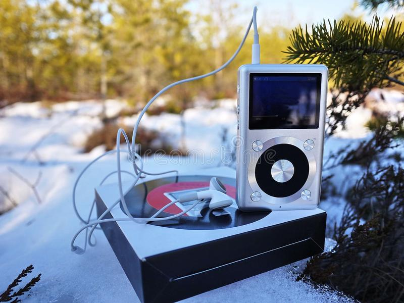 Personal MP3 player to listen to your favorite tunes, artists and music. This player takes up little space, weighs little royalty free stock photo
