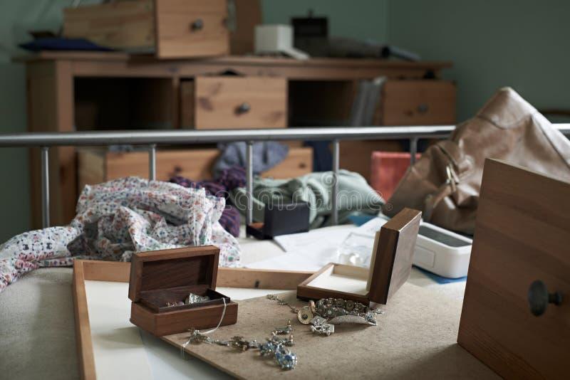 Bedroom Ransacked During Burglary. Personal Possessions Scattered Around Bedroom Ransacked During Burglary stock photography
