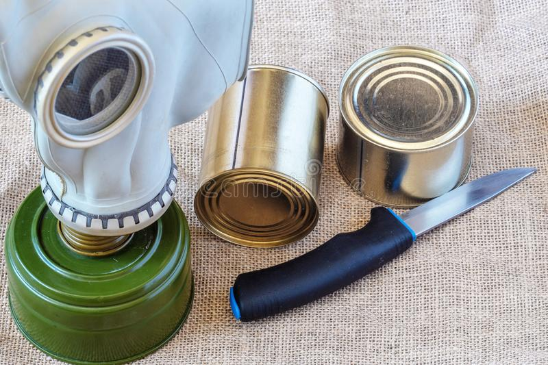 Personal protective equipment in case of an attack, food and a gas mask stock image