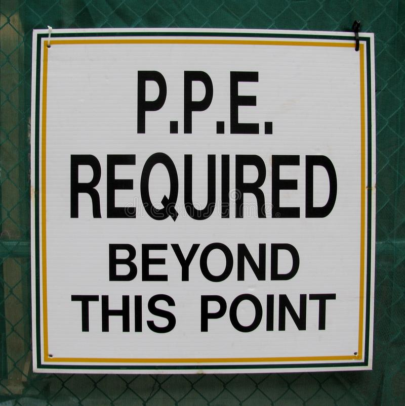 Personal protective equipment (PPE) required beyond this point sign stock image