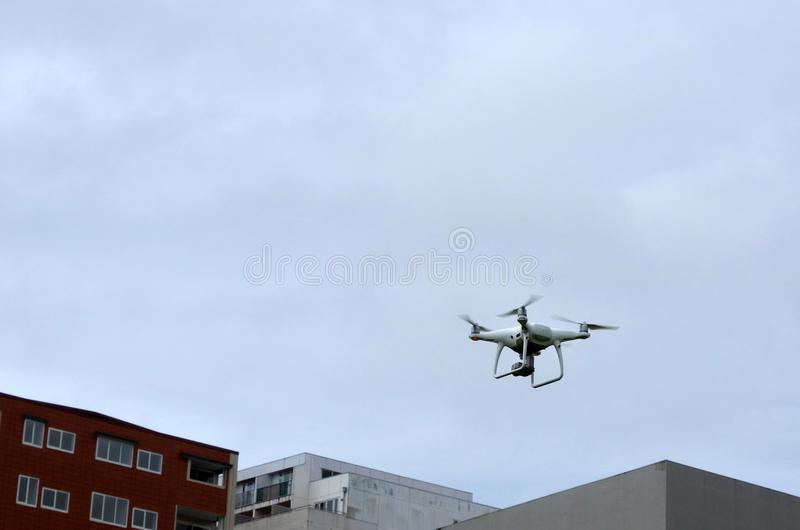 Personal quadcopter drone flies in the air stock images