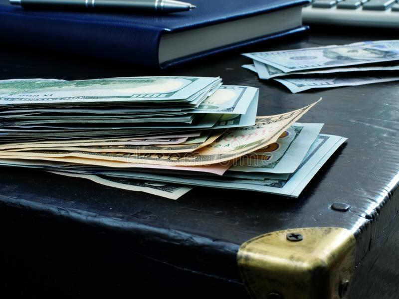 Personal savings concept. Stack of money. On an old table royalty free stock image