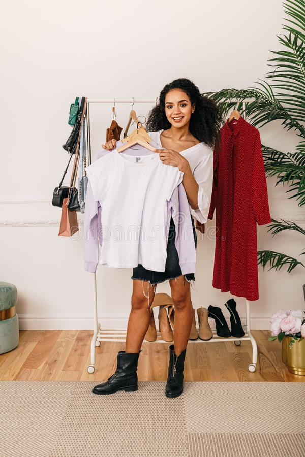 Personal stylist with clothes indoors royalty free stock photo